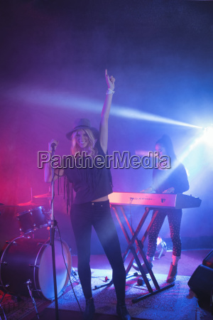 cheerful singer singing while musician playing