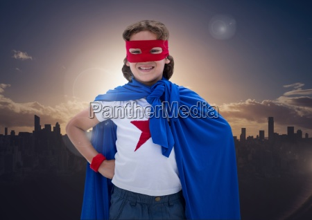 boy in superhero costume standing with