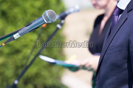 speaker speech microphone news conference