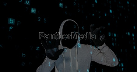 digital composite image of hacker in