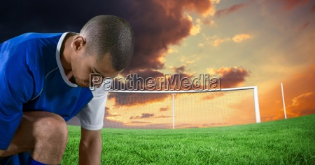 soccer player tying the shoes in