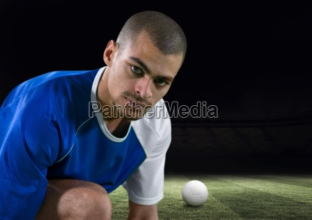 soccer player tying the laces in