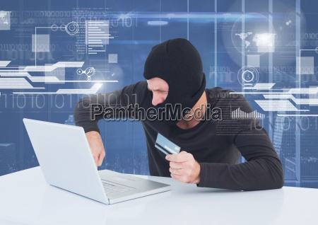 hacker using a laptop and holding