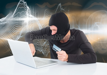 hacker with a credit card working