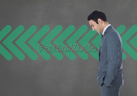 business man standing against grey background