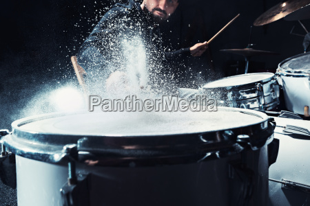 drummer rehearsing on drums before rock