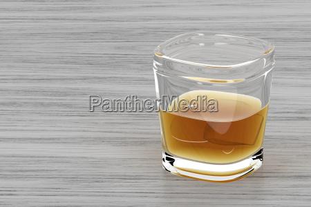 bicchiere di whisky su sfondo di