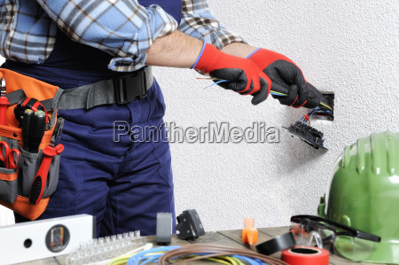 electrician at work in safety on