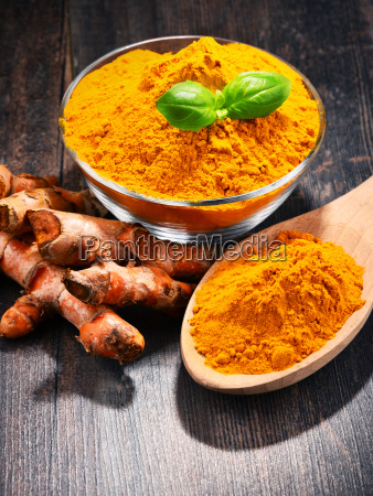 composition, with, bowl, of, turmeric, powder - 23492133