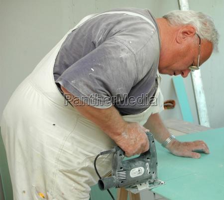 senior works with stichsage carpenter craftsman
