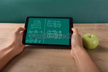 student solving math problem on digital