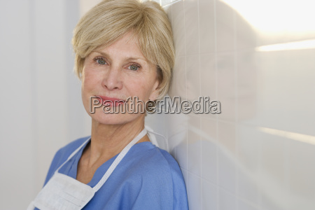 portrait of senior female doctor against