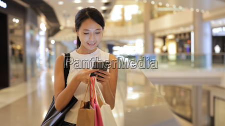 woman looking at mobile phone and