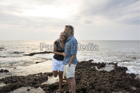 affectionate senior couple embracing at the
