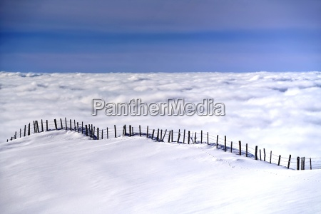 fence above the clouds