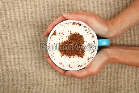 woman hands hold full latte cappuccino