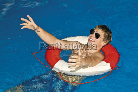 young man in the pool with