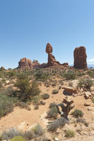 red sandstone balance ragged rock balanced