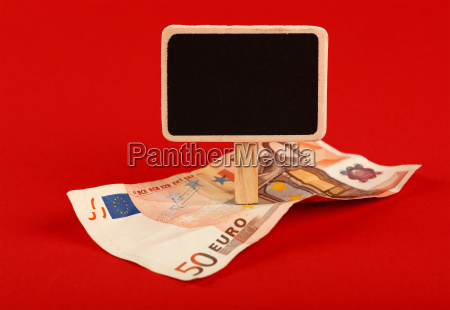 euro banknote and blackboard sign on