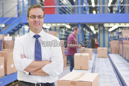 portrait of businessman in warehouse dispatch