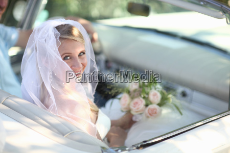 portrait of bride in open top