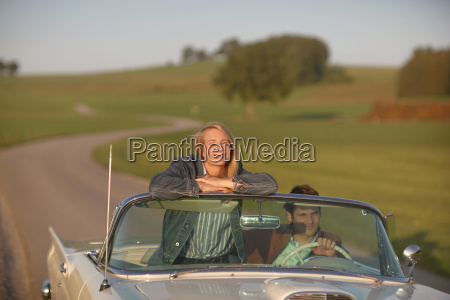 couple driving on country road in