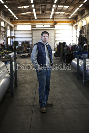 young caucasian man factory worker standing