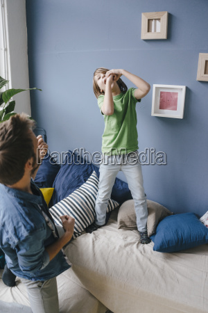 playful father and son at home