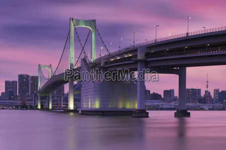 rainbow bridge and tokyo tower against