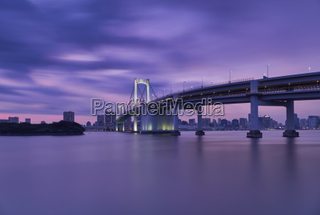 rainbow bridge over river with tokyo