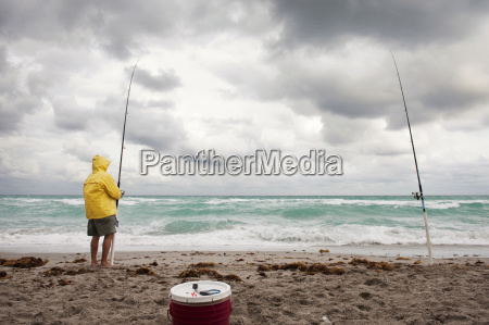 man holding fishing rod while standing