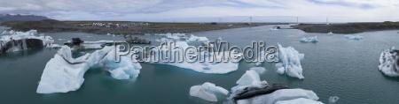 panoramic view of icebergs in water