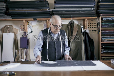 tailor with measuring tape around neck