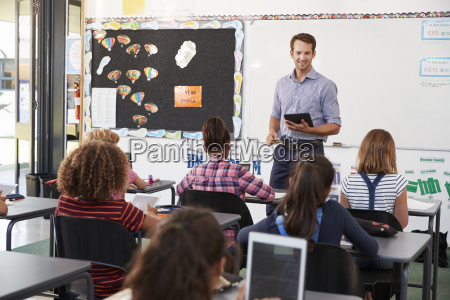 teacher with tablet in front of