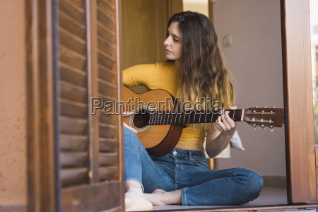 young woman sitting on the floor