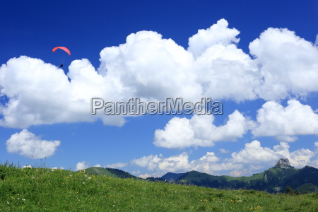 paraglider at the clouds