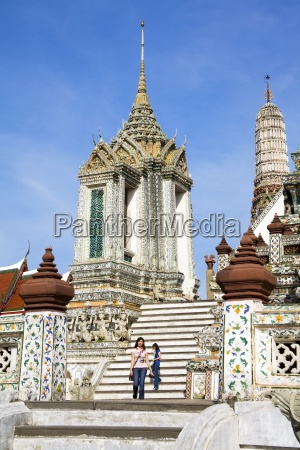 women on pagoda steps at wat