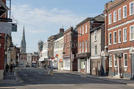 shops and pedestrians along a street