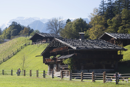 tyrolean style farm houses with green