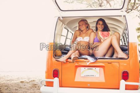 surfer girls beach lifestyle friends hanging