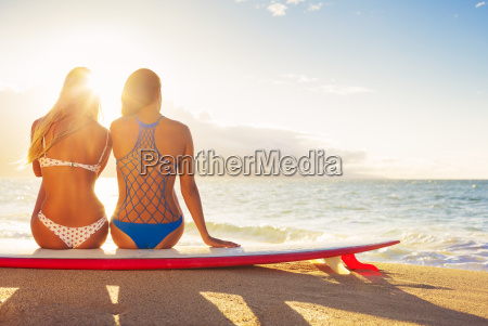 surfer girls on the beach at
