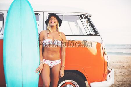 beach lifestyle beautiful surfer girl on