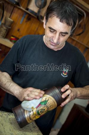 a man polishing a handmade craft