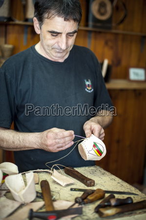 a man making handicrafts in a