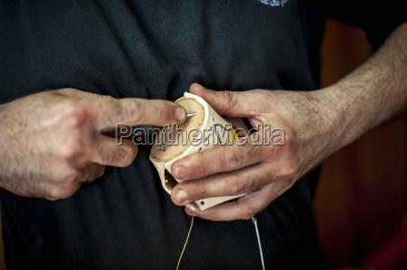 close up of a mans hands