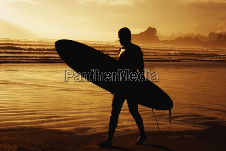 silhouette of a surfer on the