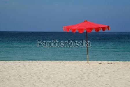 beach umbrella on tropical beach in