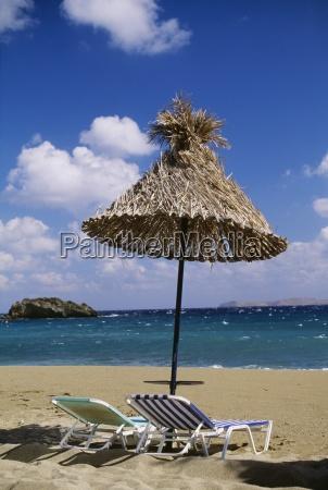 beach chairs and umbrella on beach
