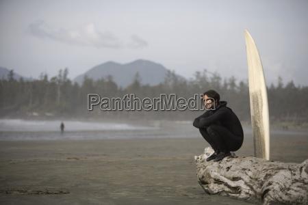 surfer on beach cox bay near