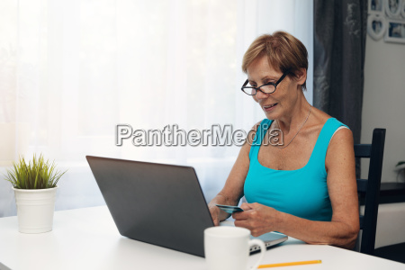 elderly woman using laptop computer and